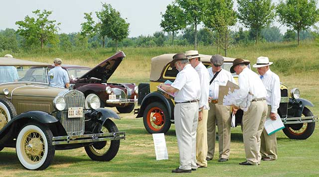 """Judges at the 2011 Concours d'Elegance evaluate their choices for """"Best of Show."""" (Combined Design Studio photo)"""