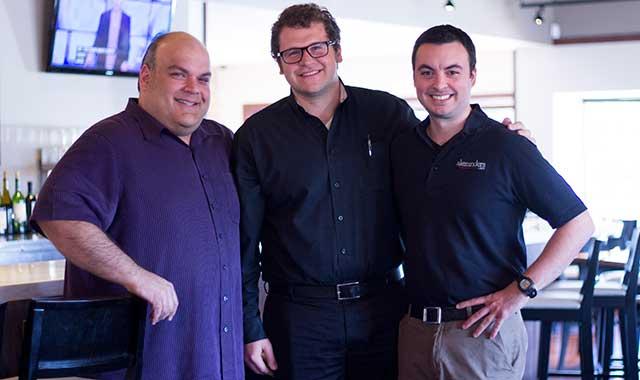 Bob Karas, with nephew Aleko Karas and cousin Nick Smith, inside the new Alexander's.