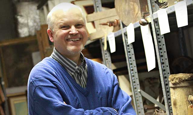 Kurt Begalka, inside the McHenry County Historical Society's storage area. (Chris Linden photo)