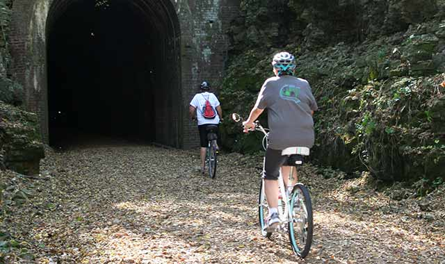 """The primitive campsites at New Glarus Woods State Park attract those who truly enjoy """"roughing it."""" The park's recreation trails lead toward nearby bike paths, including the Sugar River Trail, which has several tunnels. (Green County Tourism photo)"""