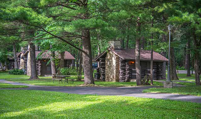 Choose from among several cabins and campground sites at White Pines State Park.